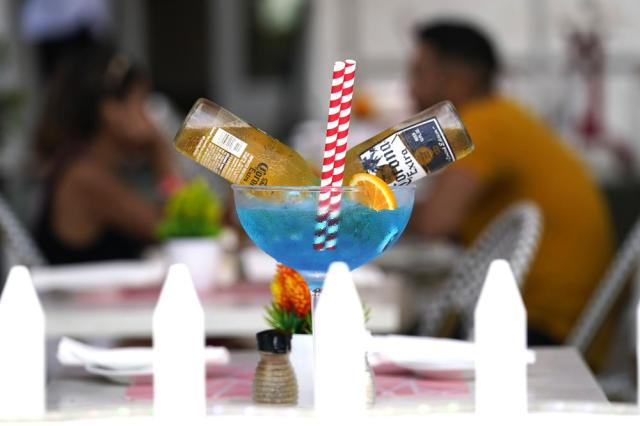 A drink is displayed at the Boulevard Restaurant along Ocean Drive, Friday, Sept. 24, 2021, in Miami Beach, Fla. For decades, this 10-block area has been one of the most glamorized spots in the world, made cool by TV shows like Miami Vice, where the sexiest models gathered at Gianni Versace's ocean front estate and rappers wrote lines about South Beach's iconic Ocean Drive. (AP Photo/Lynne Sladky)