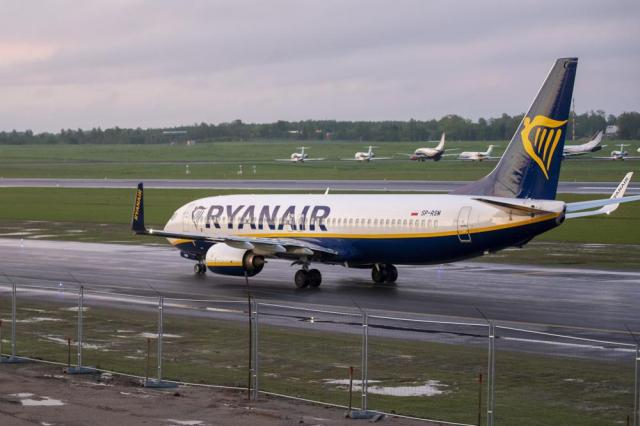 The Ryanair plane with registration number SP-RSM, carrying opposition figure Raman Pratasevich which was traveling from Athens to Vilnius and was diverted to Minsk after a bomb threat, lands at the International Airport outside Vilnius, Lithuania, Sunday, May 23, 2021. The presidential press service said President Alexander Lukashenko personally ordered that a MiG-29 fighter jet accompany the Ryanair plane carrying opposition figure Raman Pratasevich and traveling from Athens, Greece, to Vilnius, Lithuania to the airport in the capital Minsk. (AP Photo/Mindaugas Kulbis)