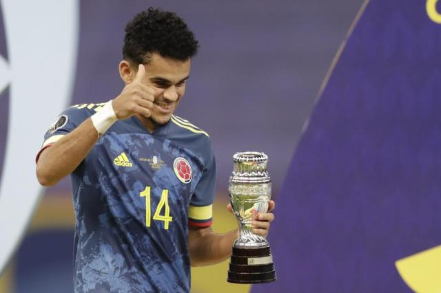 Colombia's Luis Diaz holds the best player of the match trophy after beating 3-2 Peru in the Copa America soccer match for the third place at the National stadium in Brasilia, Brazil, Friday, July 9, 2021. (AP Photo/Andre Penner)