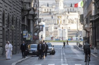 Pope Francis pays surprise visit to two churches as he strolls around Rome and offers up prayer for end to pandemic
