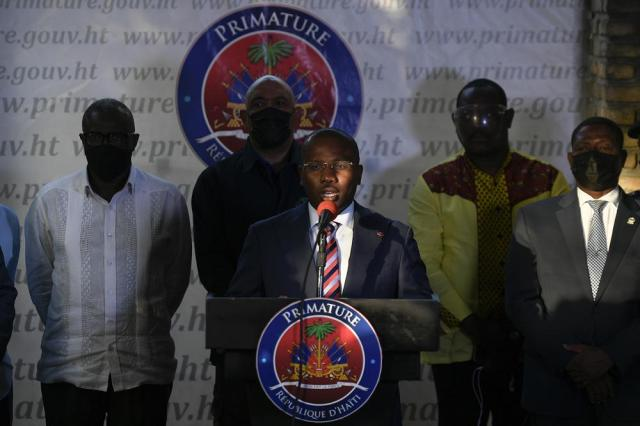 Interim President Claude Joseph speaks during a news conference at his residence in Port-au-Prince, Haiti, Sunday, July 11, 2021, four days after the assassination of Haitian President Jovenel Moise. (AP Photo/Matias Delacroix)