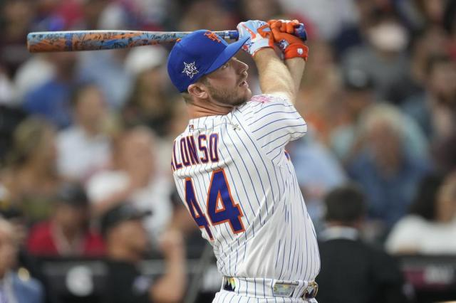 National League's Pete Alonso, of the New York Mets, hits during the second round of the MLB All Star baseball Home Run Derby, Monday, July 12, 2021, in Denver. (AP Photo/David Zalubowski)