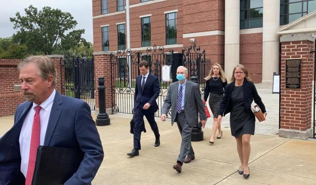 Former SCANA CEO Kevin Marsh, center, walks out of a courtroom with his lawyers after being sentenced to two years in prison for lying and deceiving the public about the progress of a pair of nuclear reactors in South Carolina that were never finished and wasted billions of dollars on Thursday, Oct. 7, in Columbia, S.C. Marsh also has pleaded guilty in state charges in the case. (AP Photo/Jeffrey Collins)