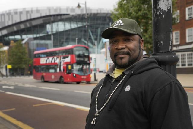Glen Percival, local resident and car mechanic, stands near the Tottenham Hotspur Stadium in London, Thursday, Oct. 7, 2021. After a one-year hiatus due to the pandemic, the NFL returns to London on Sunday when the Atlanta Falcons play the New York Jets at Premier League club Tottenham's $1.6 billion facility (AP Photo/Kirsty Wigglesworth)