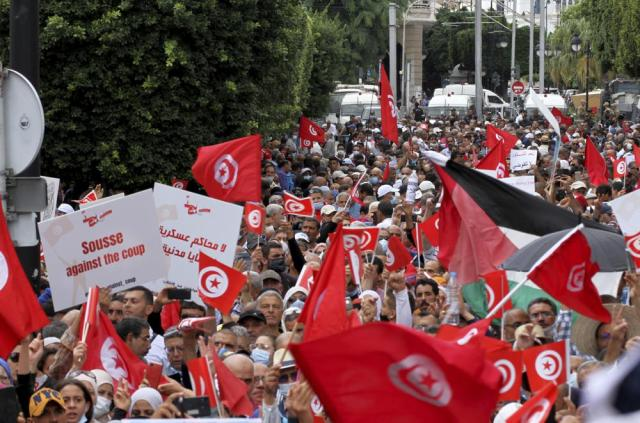 Tunisians demonstrate against Tunisian President Kais Saied in Tunis, Tunisia. Sunday, Oct. 10, 2021. Thousands of people demonstrated in Tunisia's capital Sunday against the president's seizure of powers in July and other moves seen as threatening the country's democratic gains since the Arab Spring. (AP Photo/Hassene Dridi)