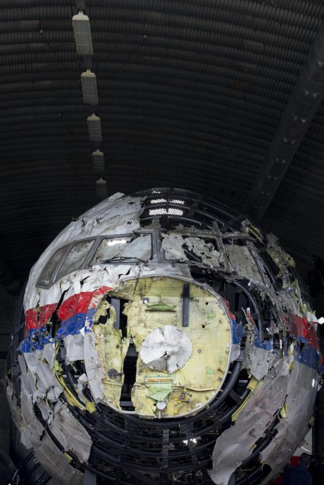 View of the reconstructed wreckage of Malaysia Airlines Flight MH17, at the Gilze-Rijen Airbase, southern Netherlands, Wednesday, May 26, 2021. (AP Photo/Peter Dejong, Pool)