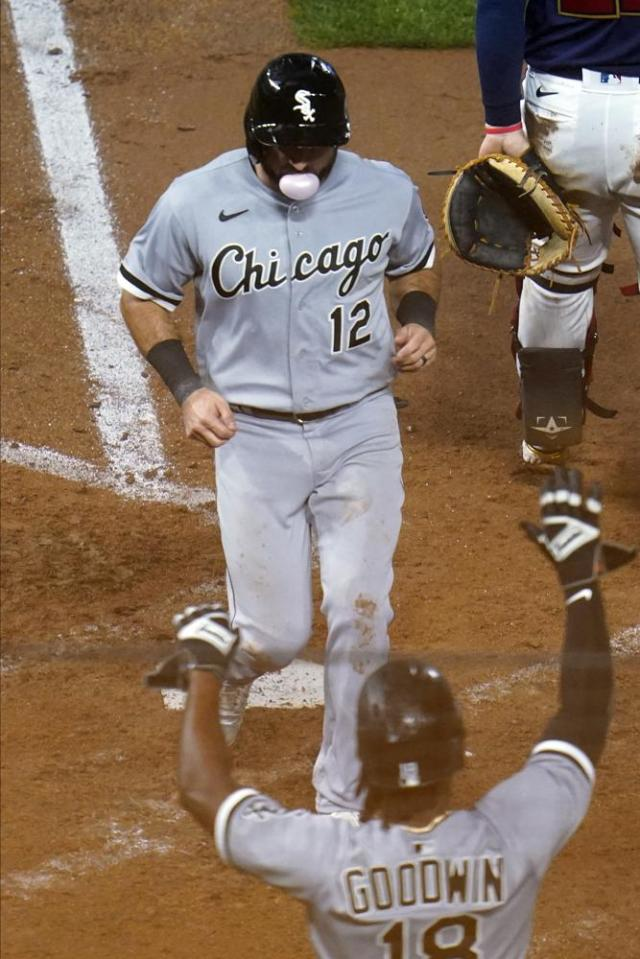 Chicago White Sox's Adam Eaton (12) scores on a sacrifice fly by Jose Abreu off Minnesota Twins relief pitcher Alex Colome in the eighth inning of a baseball game Tuesday, July 6, 2021, in Minneapolis. (AP Photo/Jim Mone)
