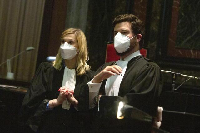 Lawyers for the European Commission Charles Edouard Lambert, right, and Fanny Laune speak prior to a hearing, European Commission vs AstraZeneca, at the main courthouse in Brussels, Wednesday, May 26, 2021. While the EU insists AstraZeneca has breached its contractual obligations, the company says it has fully complied with the agreement, arguing that vaccines are difficult to manufacture and it made its best effort to deliver on time. the European Union's executive branch will try to persuade a Brussels court Wednesday that the case is urgent enough to justify ordering the company to make an immediate delivery of the missing shots. (AP Photo/Virginia Mayo)