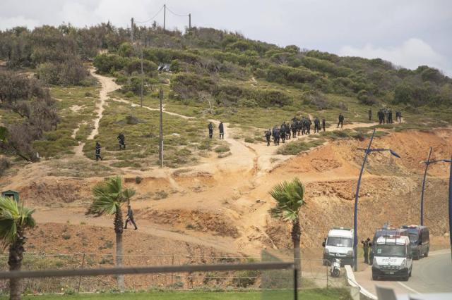 Police patrol a hill near the border in Fnideq, Morocco, for migrants trying to cross to the Spanish enclave of Ceuta, on Thursday, May 20, 2021. An extraordinary surge of migrants seeking to leave Morocco for Spain this week has left Fnideq suffering under the strain. (AP Photo/Mosa'ab Elshamy)