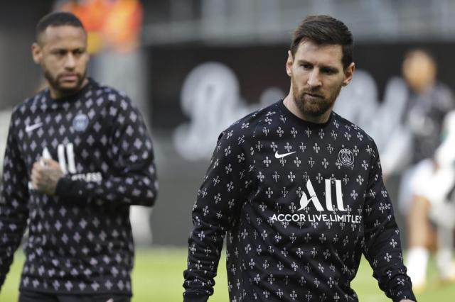 PSG's Lionel Messi, right, warms up ahead of the French League One soccer match between Rennes and Paris Saint-Germain at the Roazhon Park stadium in Rennes, France, Sunday, Oct. 3, 2021. (AP Photo/Jeremias Gonzales)