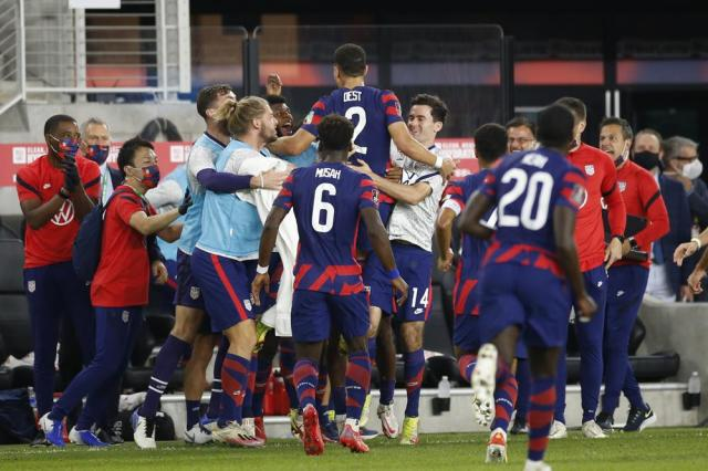 United States' Sergino Dest (2) celebrates his goal against Costa Rica with teammates during the first half of a World Cup qualifying soccer match Wednesday, Oct. 13, 2021, in Columbus, Ohio. (AP Photo/Jay LaPrete)