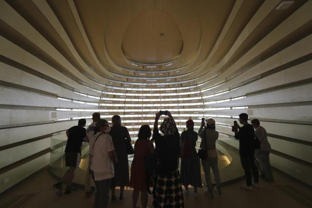 People visit the UK pavilion at the Dubai Expo 2020 in Dubai, United Arab Emirates, Saturday, Oct, 2, 2021. (AP Photo/Kamran Jebreili)