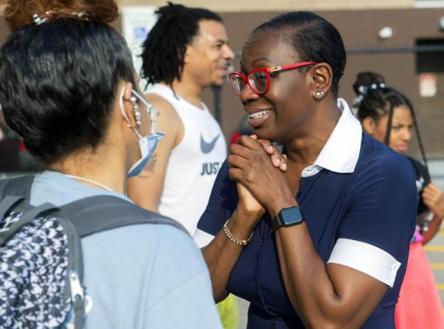 In this July 7, 2021, photo Nina Turner, a candidate running in a special Democratic primary election for Ohio's 11th Congressional District speaks with supporters at the Cuyahoga County Board of Elections after casting her vote in Cleveland. (AP Photo/Phil Long)