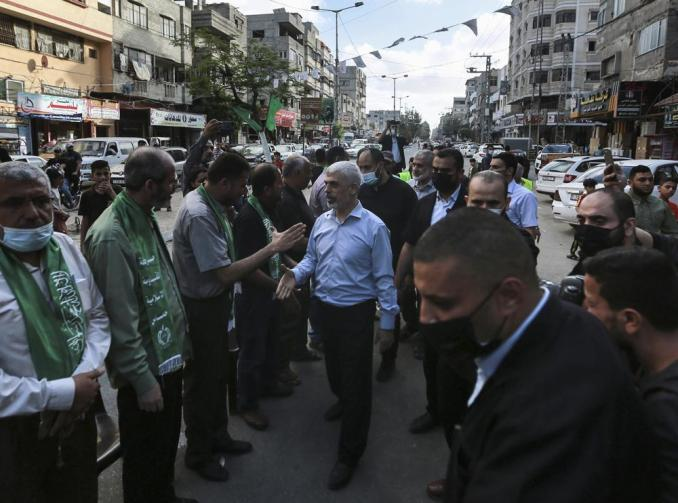 Top Hamas leader in Gaza, Yehiyeh Sinwar, center, pays his respects at a house of mourning for a Hamas commander killed in the war, in Gaza City, Saturday, May 22, 2021. Sinwar, made his first public appearance since the militant group's war with Israel erupted earlier this month. (AP Photo/Mohammed Mohammed)