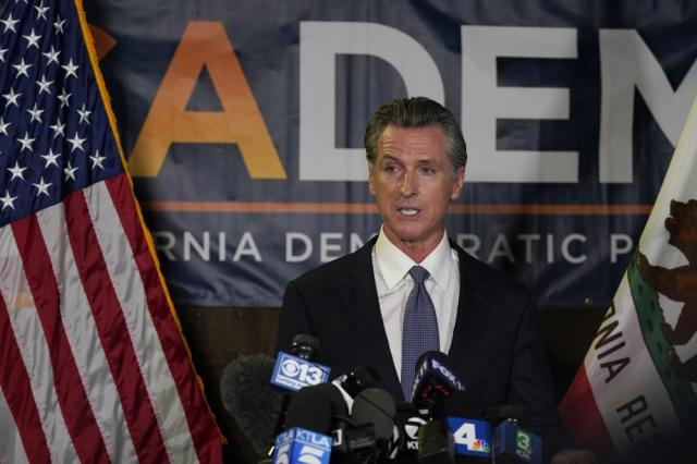 FILE - In this Sept. 14, 2021, file photo, California Gov. Gavin Newsom addresses reporters after defeating recall-attempt that aimed to remove him from office, at the John L. Burton California Democratic Party headquarters in Sacramento, Calif. Newsom on Thursday, Sept. 16, 2021, approved two measures to slice through local zoning ordinances as the most populous state struggles with soaring home prices, an affordable housing shortage and stubborn homelessness. Newsom also signed a bill extending a 2019 law designed to make it easier to build more housing throughout the state. (AP Photo/Rich Pedroncelli, File)