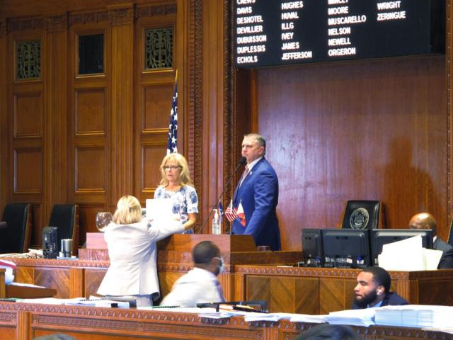 House Speaker Clay Schexnayder, R-Gonzales, standing at the right, looks over the House chamber after speaking with staff at his desk on the last day of the legislative session, Thursday, June 10, 2021, in Baton Rouge, La. (AP Photo/Melinda Deslatte)