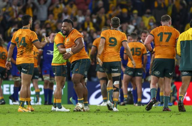 Australian players celebrate following the rugby international between France and Australia at Suncorp Stadium in Brisbane, Australia, Wednesday, July 7, 2021. (AP Photo/Tertius Pickard)