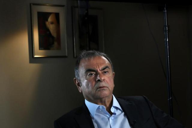 Former Nissan executive Carlos Ghosn speaks during an interview with The Associated Press, in Dbayeh, north of Beirut, Lebanon, Tuesday, May 25, 2021. The embattled former chairman of the Renault-Nissan-Mitsubishi alliance dissected his legal troubles in Japan, France and the Netherlands, detailed how he plotted his brazen escape from Osaka, and reflected on his new reality in crisis-hit Lebanon, where he is stuck for the foreseeable future. (AP Photo/Hussein Malla)
