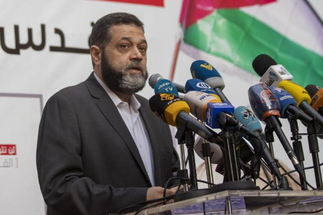 Senior Hamas official Osama Hamdan speaks during a rally organized by Lebanon's militant Hezbollah group to express solidarity with the Palestinian people, in the southern suburb of Beirut, Lebanon, Monday, May 17, 2021.  Hamdan says he expects a cease-fire between the group's Gaza branch and Israel within 24 hours, on Thursday, May 20.   He tells The Associated Press that Egypt and Qatar are mediating and that progress is being made. (AP Photo/Hassan Ammar)