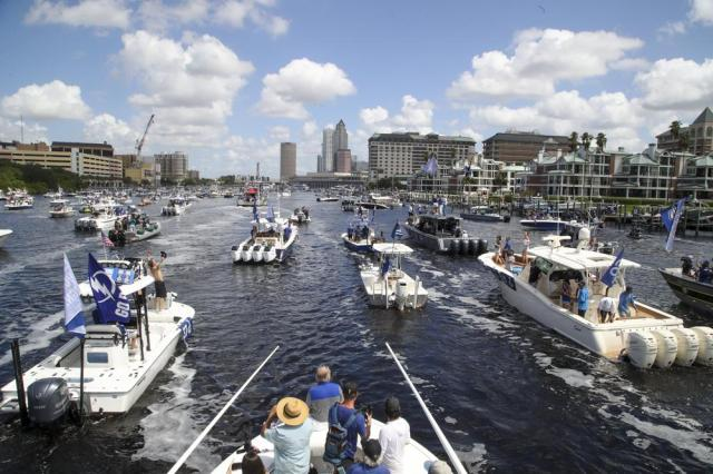 Boats make their way up the Hillsborough River during a parade celebrating the Tampa Bay Lightning NHL hockey Stanley Cup victory Monday, July 12, 2021, in Tampa, Fla. (Dirk Shadd/Tampa Bay Times via AP)