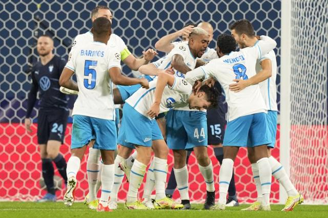 Zenit's Daler Kuzyaev, center, celebrates after scoring his side's second goal during the Champions League, group H, soccer match, between Zenit St. Petersburg and Malmo at the Gazprom Arena in St.Petersburg, Russia, Wednesday, Sept. 29, 2021. (AP Photo/Dmitry Lovetsky)