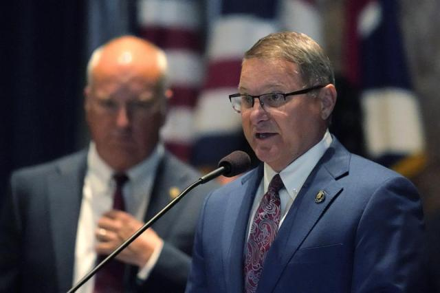 Senate President Page Cortez speaks at the start of a veto session in Baton Rouge, La., Tuesday, July 20, 2021. Behind him is Sen. Jay Morris, R-Monroe. Louisiana state senators have narrowly voted to overturn Democratic Gov. John Bel Edwards' rejection of a bill prohibiting transgender students from participating in school sports. The vote came Tuesday on the opening day of the first veto session under the state's nearly 50-year-old constitution. (AP Photo/Gerald Herbert)
