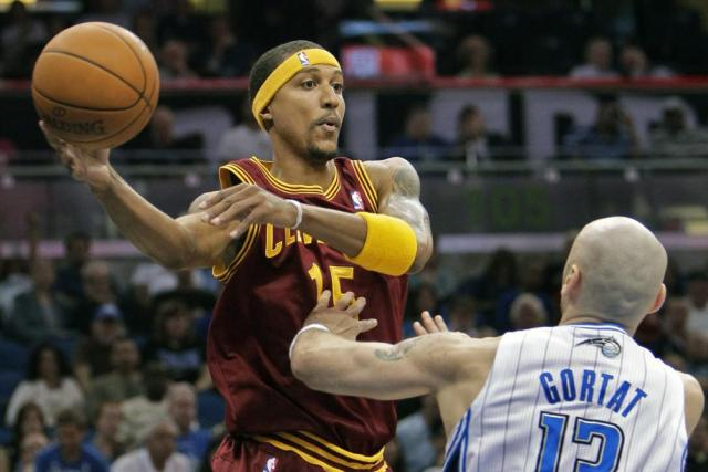 FILE - Cleveland Cavaliers' Jamario Moon, left, makes a pass over the head of Orlando Magic's Marcin Gortat (13), of Poland, during the first half of an NBA basketball game in Orlando, Fla., in this Friday, Nov. 26, 2010, file photo. Eighteen former NBA players, including Moon, have been arrested on charges alleging they defrauded the league's health and welfare benefit plan out of about $4 million, according to an indictment Thursday, Oct. 7, 2021. (AP Photo/John Raoux, File)