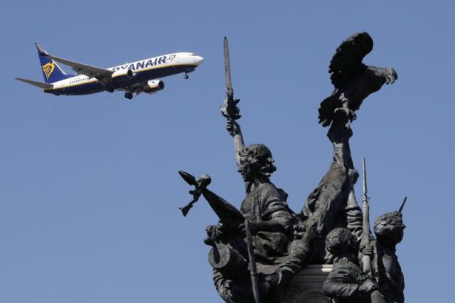 FILE - In this Wednesday, Aug. 21, 2019 file photo, a Ryanair airplane approaching landing at Lisbon airport flies past the Monument to the Heroes of the Peninsular War, in the foreground. A top European Union court on Wednesday, May 19, 2021 annulled the EU's approval of 3.4 billion euros in state aid for the Dutch carrier KLM but suspended its immediate application because of the impact of the COVID-19 pandemic on the industry. In a similar ruling backing a challenge from Irish air carrier Ryanair, the court also annulled the EU's decision to back state aid to the TAP Portuguese carrier for a potential total of 1.2 billion euros, but also suspended its application pending a new EU decision. (AP Photo/Armando Franca, File)