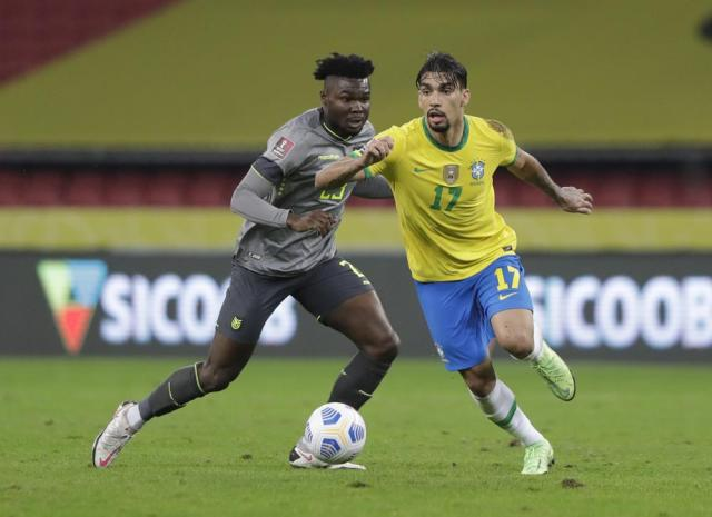 Brazil's Lucas Paqueta, left, and Ecuador's Jordy Caicedo fight for the ball during a qualifying soccer match for the FIFA World Cup Qatar 2022 at Beira-Rio stadium in Porto Alegre, Brazil, Friday, June 4, 2021. (AP Photo/Andre Penner)
