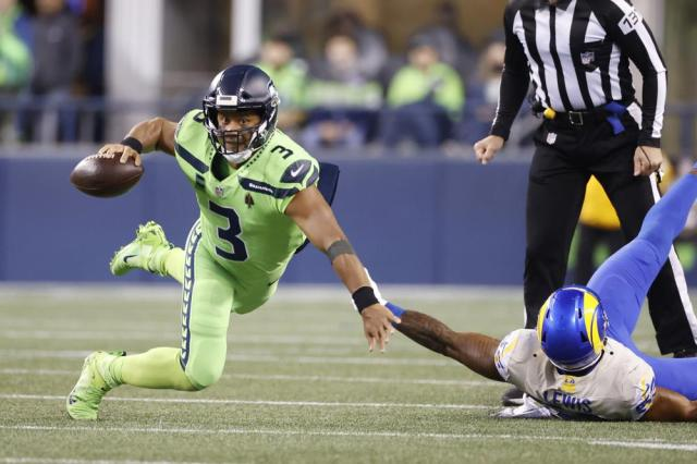 Seattle Seahawks quarterback Russell Wilson goes down as he tries to get a pass off against the Los Angeles Rams during the second half of an NFL football game, Thursday, Oct. 7, 2021, in Seattle. (AP Photo/Craig Mitchelldyer)
