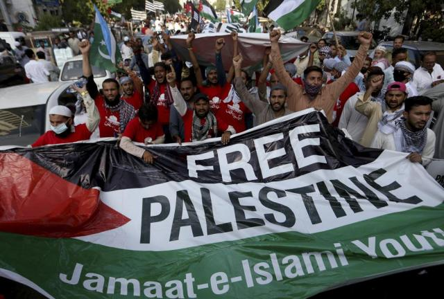 Supporters of the Pakistani religious group' Jamaat-e-Islami' chant slogans during a rally near U.S consulate, in support of Palestinians, in Karachi, Pakistan, Friday, May 21, 2021. (AP Photo/Fareed Khan)