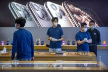 Apple warns China virus will cut iPhone production, sales