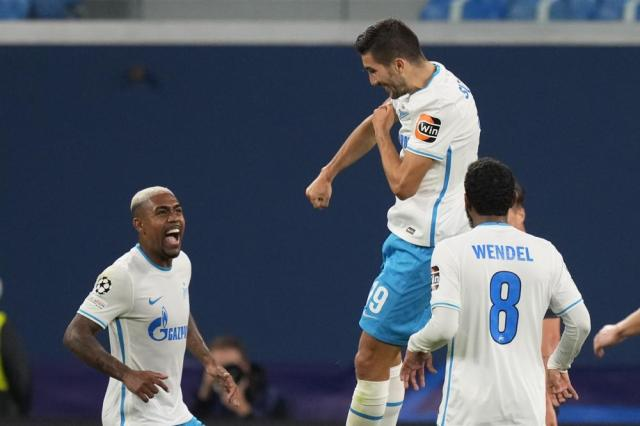 Zenit's Aleksey Sutormin, top, celebrates after scoring his side's third goal during the Champions League, group H, soccer match, between Zenit St. Petersburg and Malmo at the Gazprom Arena in St.Petersburg, Russia, Wednesday, Sept. 29, 2021. (AP Photo/Dmitry Lovetsky)