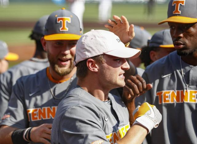 Tennessee outfielder Evan Russell (6) is congratulated by teammates after hitting a home run during an NCAA college baseball super regional game against LSU Sunday, June 13, 2021, in Knoxville, Tenn. Tennessee won 15-6 to advance. (AP Photo/Wade Payne)