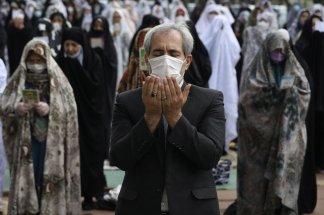 Muslims celebrate Eid al-Fitr, amid curfews and virus fears