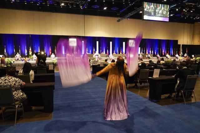 A dancer performs during the opening worship service at the African Methodist Episcopal Church conference,  Tuesday, July 6, 2021, in Orlando, Fla. (AP Photo/John Raoux)