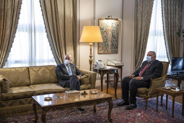 Greek Foreign Minister Nikos Dendias, left, meets with Egyptian Foreign Minister Sameh Shoukry, at the foreign ministry in Cairo, Egypt, Thursday, May 20, 2021. (AP Photo/Nariman El-Mofty)