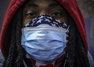 People in communities of color express fears of being profiled while wearing masks or other face coverings in public