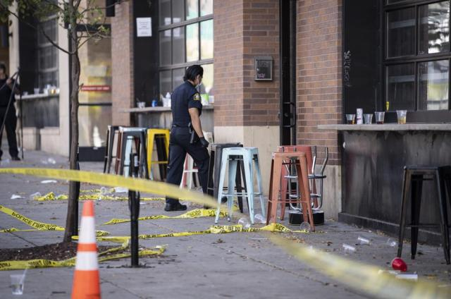 Investigators processed the chaotic scene of a multiple shooting at the bar Truck Park in St. Paul, Minn., that happened after midnight on Sunday, Oct. 10, 2021. (Renee Jones Schneider/Star Tribune via AP)
