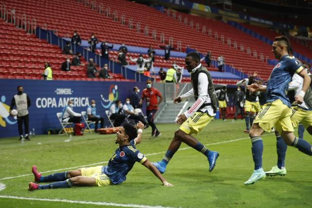 Colombia's Luis Diaz celebrates scoring his side's third goal against Peru during the Copa America third place soccer match at the National stadium in Brasilia, Brazil, Friday, July 9, 2021. (AP Photo/Andre Penner)