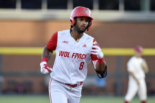 North Carolina State base runner Jose Torres (8) rounds the basses after hitting the go ahead home run against Arkansas in the ninth inning of an NCAA college baseball super regional game Sunday, June 13, 2021, in Fayetteville, Ark. (AP Photo/Michael Woods)