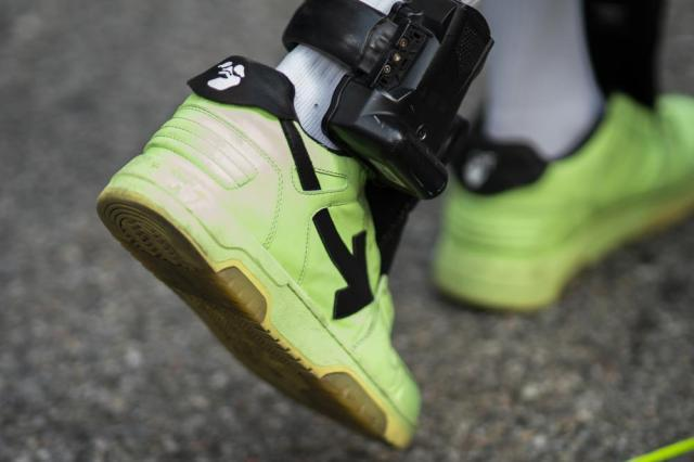 Former NBA basketball player Sebastian Telfair wears an ankle monitor as he departs departs Manhattan Federal Court, Thursday, Oct. 7, 2021, in New York. Federal authorities say 18 former NBA players, including Telfair, have been charged with allegedly pocketing $2.5 million illegally by defrauding the league's health and welfare benefit plan. (AP Photo/Eduardo Munoz Alvarez)