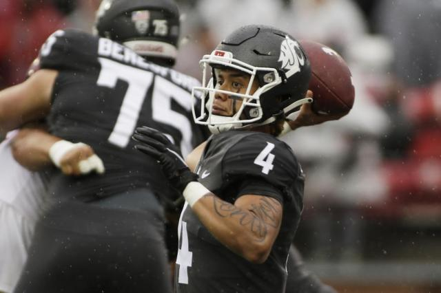 Washington State quarterback Jayden de Laura throws a pass during the first half of an NCAA college football game against Southern California, Saturday, Sept. 18, 2021, in Pullman, Wash. (AP Photo/Young Kwak)