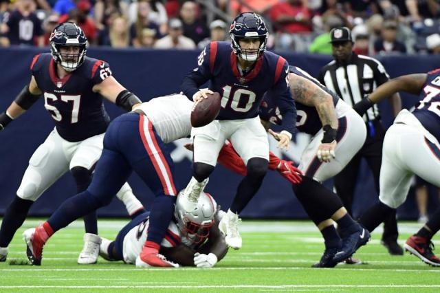 Houston Texans quarterback Davis Mills breaks away from New England Patriots defenders during the first half of an NFL football game Sunday, Oct. 10, 2021, in Houston. (AP Photo/Justin Rex)