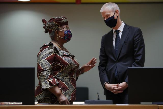 World Trade Organization Director-General Ngozi Okonjo-Iweala, left, talks to France's Foreign Trade Minister Franck Riester during a European Foreign Trade ministers meeting at the European Council headquarters in Brussels, Thursday, May 20, 2021. (AP Photo/Francisco Seco, Pool)