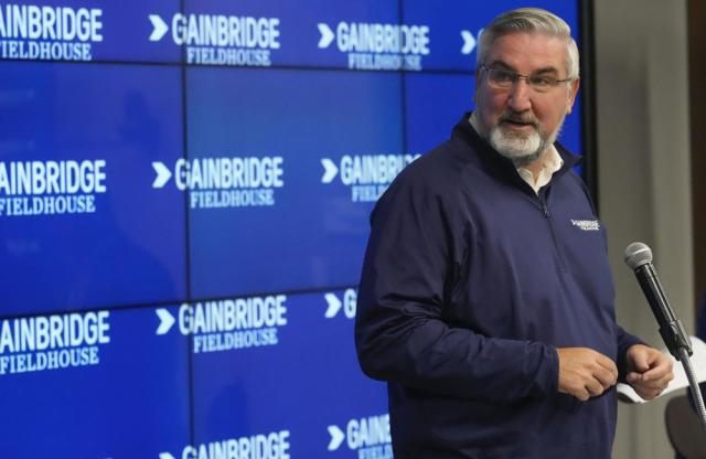 Indiana Gov. Eric Holcomb speaks during a news conference announcing that the Indiana Pacers basketball arena will be renamed Gainbridge Fieldhouse during the NBA basketball team's media day in Indianapolis, Monday, Sept. 27, 2021. (AP Photo/AJ Mast)