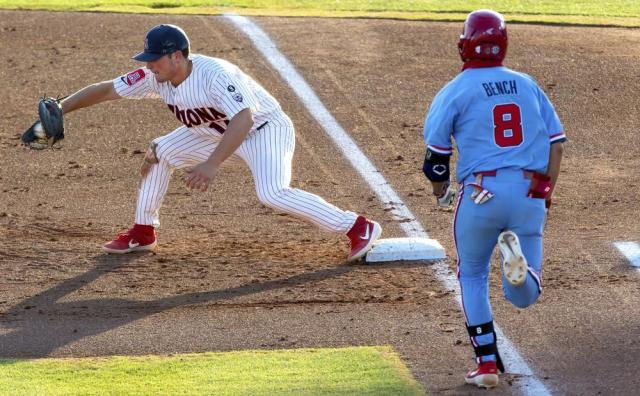 Arizona first baseman Branden Boissiere, left, gets Mississippi's Justin Bench (8) out at first base during an NCAA college baseball super regional game Sunday, June 13, 2021, in Tucson, Ariz. (Rebecca Sasnett/Arizona Daily Star via AP)