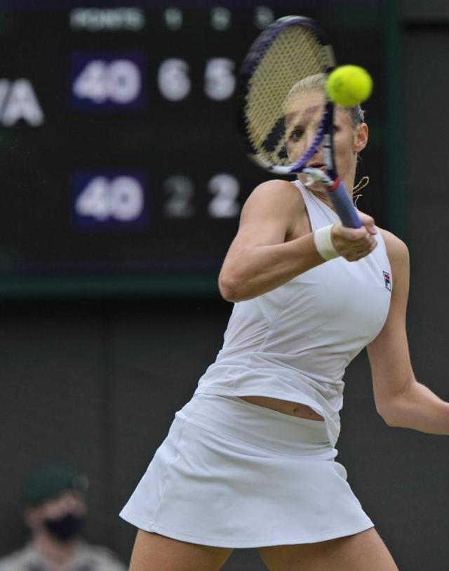 Czech Republic's Karolina Pliskova plays a return to Switzerland's Viktorija Golubic on day eight of the Wimbledon Tennis Championships in London, Tuesday, July 6, 2021. (AP Photo/Alastair Grant)