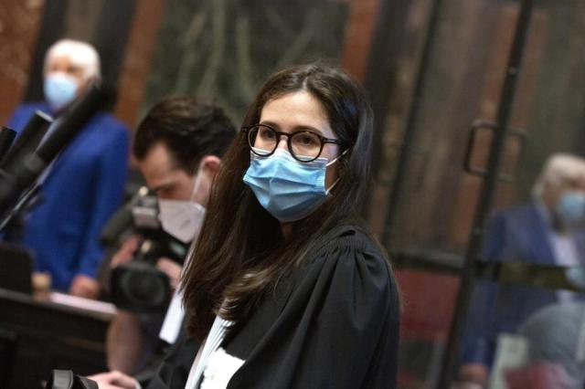 Lawyer for AstraZeneca Clemence Van Muylder waits for the start of a hearing, European Commission vs AstraZeneca, at the main courthouse in Brussels, Wednesday, May 26, 2021. The European Union took on vaccine producer AstraZeneca in a Brussels court on Wednesday with the urgent demand that the company needs to make an immediate delivery of COVID-19 shots the 27-nation bloc insists were already due. (AP Photo/Virginia Mayo)