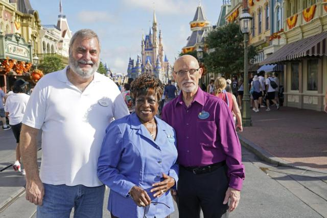Walt Disney World employees from left, Chuck Milam, Earliene Anderson and Forrest Bahruth gather at the Magic Kingdom Monday, Aug. 30, 2021, in Lake Buena Vista, Fla. to celebrate their 50 years working at the park. (AP Photo/John Raoux)